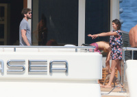 Nina Dobrev and Asustin Stowell enjoy the ocean off the cost the French Riviera (July 26) TDTfrFld