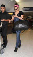 Nina Dobrev at LAX Airport (March 27) U6gafr56