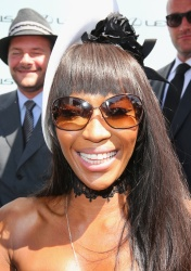 Naomi Campbell poses at the Lexus Marquee on Victoria Derby Day at Flemington Racecourse in Melbourne 2.11.2013 17