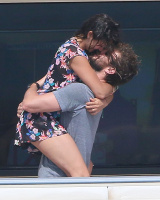 Nina Dobrev and Asustin Stowell enjoy the ocean off the cost the French Riviera (July 26) RKA5TKsM