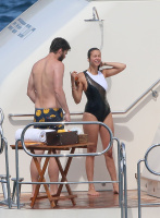 Nina Dobrev and Asustin Stowell enjoy the ocean off the cost the French Riviera (July 26) ZYXaQBcs