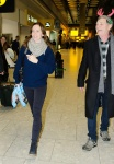 Emily Blunt with her husband fly into Heathrow Airport London December  23-2015 x9