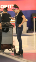 Nina Dobrev at LAX Airport (March 27) Kp2STVyw