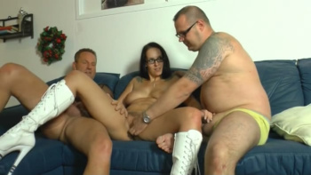 Very hot german gal in boots takes 2 cocks