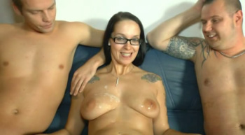 Hot german lady with glasses takes it by 2 guys