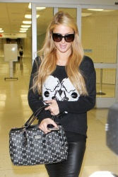 Paris Hilton Arrives at LAX 25-11-2014