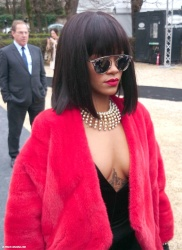 Rihanna showed up at the Dior Fashion Show during Paris Fashion Week Womenswear Fall Winter 2014-2015 on Friday February 28 2014