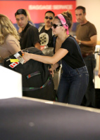 Nina Dobrev at LAX Airport (March 27) UM10XN5B