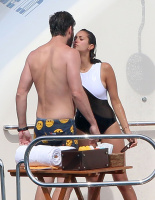 Nina Dobrev and Asustin Stowell enjoy the ocean off the cost the French Riviera (July 26) LY5zdW4b
