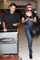 Nina Dobrev at LAX Airport (March 27) KJ5u5vZG