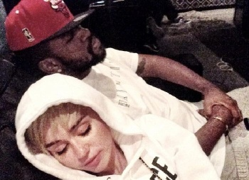 Miley Cyrus with her new beau, Mike will.