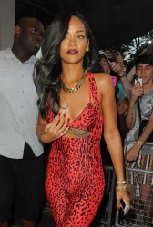 Rihanna - In A Red Catsuit Leaving the Roberto Cavalli store in London - July 19, 2013