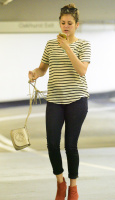 Nina Dobrev heads to a medical building chatting on her cell (June 03) RfJyNchb