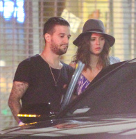 Nina Dobrev and Mark Ballas hanging out with friends outside a local LA (August 22)  XxEM7wKG