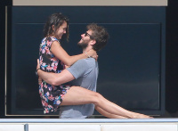 Nina Dobrev and Asustin Stowell enjoy the ocean off the cost the French Riviera (July 26) DDm3M1sb