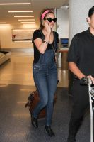 Nina Dobrev at LAX Airport (March 27) LAmuvcN0