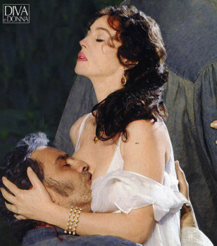 Andrea Bocelli kissing deep inside the cleavage of Monica Bellucci