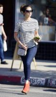 Nina Dobrev heads to a medical building chatting on her cell (June 03) QsRCTG7o