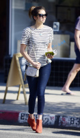 Nina Dobrev heads to a medical building chatting on her cell (June 03) CkEAUAt9