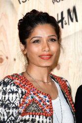 Freida Pinto - 'Isabel Marant for H&M' photocall in Paris 10/24/13
