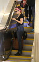 Nina Dobrev at LAX Airport (March 27) AWfCrujI