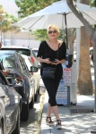 Sharon Stone Smiles picking up her car at valet parking for Villa Blanca August 11-2015 x8