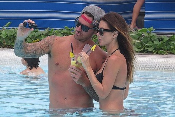 While the rest of us suckers are busy working today, the blue birds, Audrina Patridge and boyfriend, Corey Bohan got to relax for a romantic moment at the beach in Bali on Friday, June 20, 2014.