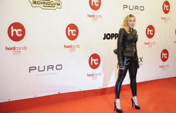 madonna attends the grand opening of her hard candy fitness club leather celebrities. Black Bedroom Furniture Sets. Home Design Ideas